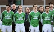 22 January 2012; Fermanagh manager Peter Canavan, back centre, along with his assistant managers Enda Kilpatrick, left, and Kieran Donnelly, right, stand behind players, from left, Seamus Quigley, Conor Quigley, Barry Owens and Ryan McCluskey during the National Anthem. Power NI Dr. McKenna Cup, Semi-Final, Tyrone v Fermanagh, Morgan Athletic Grounds, Armagh. Picture credit: Oliver McVeigh / SPORTSFILE