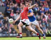 10 June 2017; Donncha O'Connor of Cork in action against George Hannigan of Tipperary during the Munster GAA Football Senior Championship Semi-Final match between Cork and Tipperary at Pairc Ui Rinn in Cork. Photo by Matt Browne/Sportsfile