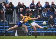 11 June 2017; Paul Geaney of Kerry scores a point despite the attentions of Kevin Harnett of Clare during the Munster GAA Football Senior Championship Semi-Final match between Kerry and Clare at Cusack Park, in Ennis, Co. Clare. Photo by Sam Barnes/Sportsfile