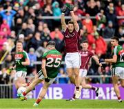 11 June 2017; Evan Regan of Mayo under pressure from Michael Lundy of Galway takes a last second kick on goal, which went wide, during the Connacht GAA Football Senior Championship Semi-Final match between Galway and Mayo at Pearse Stadium, in Salthill, Galway. Photo by Ray McManus/Sportsfile