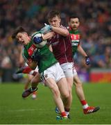 11 June 2017; Fergal Boland of Mayo in action against David Wynne of Galway during the Connacht GAA Football Senior Championship Semi-Final match between Galway and Mayo at Pearse Stadium, in Salthill, Galway. Photo by Ray McManus/Sportsfile