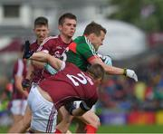 11 June 2017; Andy Moran of Mayo in action against Liam Silke, left, and Cathal Sweeney of Galway during the Connacht GAA Football Senior Championship Semi-Final match between Galway and Mayo at Pearse Stadium, in Salthill, Galway. Photo by Ray McManus/Sportsfile