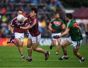 11 June 2017; Seán Armstrong of Galway in action against Chris Barrett of Mayo during the Connacht GAA Football Senior Championship Semi-Final match between Galway and Mayo at Pearse Stadium, in Salthill, Galway. Photo by Ray McManus/Sportsfile