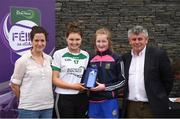 12 June 2017; Rebecca Farrell from Knockavilla Donaskeigh Kickhams GAA Club, Co Tipperary, pictured with Carlow's Kate Nolan, Anne-Claire Monde, left, John West Marketing Manager, and Martin Skelly, right, Chairman, National Féile Committee, after finishing third in the camogie competition at the John West Skills Day in the National Sports Campus on Saturday 10th June. The Skills Day is an opportunity for Ireland's rising football, hurling & camogie stars to show their skills ahead of the John West Féile na nÓg and John West Féile na nGael competitions. At Abbottstown in Dublin.  Photo by Cody Glenn/Sportsfile
