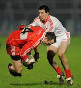 28 January 2012; Paddy Bradley, Derry, in action against PJ Quinn, Tyrone. Power NI Dr. McKenna Cup Final, Derry v Tyrone, Morgan Athletic Grounds, Armagh. Picture credit: Oliver McVeigh / SPORTSFILE