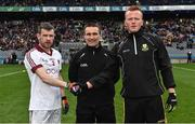 17 March 2017; Team captains Francis McEldowney of Slaughtneil and Johnny Buckley of Dr. Crokes shake hands in the company of referee Maurice Deegan ahead of the AIB GAA Football All-Ireland Senior Club Championship Final match between Dr. Crokes and Slaughtneil at Croke Park in Dublin. Photo by Brendan Moran/Sportsfile
