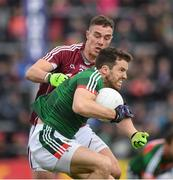 11 June 2017; Chris Barrett of Mayo in action against Michael Lundy of Galway during the Connacht GAA Football Senior Championship Semi-Final match between Galway and Mayo at Pearse Stadium, in Salthill, Galway. Photo by Ray McManus/Sportsfile
