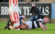 1 February 2012; Seamus Glynn, PBC, scores his side's winning try, despite the tackle of Greg O'Shea, Cresent CC. Avonmore Munster Schools Rugby Senior Cup, Round 1, PBC v Cresent CC, Musgrave Park, Cork. Picture credit: Matt Browne / SPORTSFILE