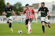 16 June 2017; Aaron McEneff of Derry City in action against Kevin Lynch, left, and Mark Salmon of Bray Wanderers during the SSE Airtricity League Premier Division match between Bray Wanderers and Derry City at the Carlisle Grounds in Bray, Co Wicklow. Photo by Piaras Ó Mídheach/Sportsfile