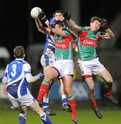 4 February 2012; Barry Moran and Seamus O'Shea, right, Mayo, in action against Brendan Quigley, 3, and Kieran Lillis, Laois. Allianz Football League, Division 1, Round 1, Laois v Mayo, O'Moore Park, Portlaoise, Co. Laois. Picture credit: Matt Browne / SPORTSFILE