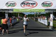17 June 2017; Kevin Maunsell crosses the finish line to win the Irish Runner 5 Mile at the Phoenix Park in Dublin. Photo by Sam Barnes/Sportsfile