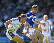 17 June 2017; Dean Healy of Wicklow in action against Brendan Quigley of Laois during the GAA Football All-Ireland Senior Championship Round 1A match between Wicklow and Laois at Joule Park in Aughrim, Co Wicklow. Photo by Ray McManus/Sportsfile