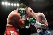17 June 2017; Lewis Crocker, right, in action against Radoslav Mitev during their Welterweight bout at the Battle of Belfast Fight Night at the Waterfront Hall in Belfast. Photo by Ramsey Cardy/Sportsfile