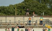 17 June 2017; A spectator looks on from a nearby roof during the Leinster GAA Football Senior Championship Semi-Final match between Meath and Kildare at Bord na Móna O'Connor Park in Tullamore, Co Offaly. Photo by Piaras Ó Mídheach/Sportsfile