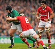5 February 2012; Mike Ross, Ireland, is tackled by Toby Faletau, Wales. RBS Six Nations Rugby Championship, Ireland v Wales, Aviva Stadium, Lansdowne Road, Dublin. Picture credit: Stephen McCarthy / SPORTSFILE