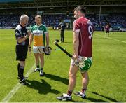 18 June 2017; Referee Johnny Ryan with captains Seán Ryan of Offaly and David Burke of Galway during the coin toss ahead of the Leinster GAA Hurling Senior Championship Semi-Final match between Galway and Offaly at O'Moore Park in Portlaoise, Co Laois. Photo by Seb Daly/Sportsfile