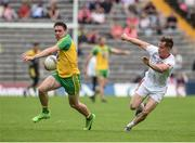 18 June 2017; Martin Reilly of Donegal  in action against Kieran McGeary of Tyrone during the Ulster GAA Football Senior Championship Semi-Final match between Tyrone and Donegal at St Tiernach's Park in Clones, Co. Monaghan. Photo by Oliver McVeigh/Sportsfile