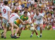 18 June 2017; Eoghan Ban Gallagher of Donegal in action against Peter Harte and Matthew Donnelly of Tyrone during the Ulster GAA Football Senior Championship Semi-Final match between Tyrone and Donegal at St Tiernach's Park in Clones, Co. Monaghan. Photo by Oliver McVeigh/Sportsfile