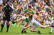18 June 2017; Jamie Brennan of Donegal  in action against Conall McCann of Tyrone during the Ulster GAA Football Senior Championship Semi-Final match between Tyrone and Donegal at St Tiernach's Park in Clones, Co. Monaghan. Photo by Oliver McVeigh/Sportsfile