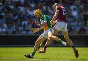 18 June 2017; Niall Burke of Galway scores a point while under pressure from Paddy Murphy of Offaly during the Leinster GAA Hurling Senior Championship Semi-Final match between Galway and Offaly at O'Moore Park in Portlaoise, Co Laois. Photo by Seb Daly/Sportsfile