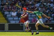 18 June 2017; Conor Whelan of Galway scores a point while under pressure from Pádraic Guinan of Offaly during the Leinster GAA Hurling Senior Championship Semi-Final match between Galway and Offaly at O'Moore Park in Portlaoise, Co Laois. Photo by Seb Daly/Sportsfile