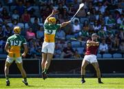 18 June 2017; Johnny Coen of Galway scores a point despite the attention of Shane Kinsella of Offaly during the Leinster GAA Hurling Senior Championship Semi-Final match between Galway and Offaly at O'Moore Park in Portlaoise, Co Laois. Photo by Seb Daly/Sportsfile