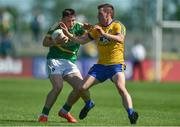 18 June 2017; James Rooney of Leitrim in action against Conor Devaney of Roscommon during the Connacht GAA Football Senior Championship Semi-Final match between Roscommon and Leitrim at Dr Hyde Park in Roscommon. Photo by David Maher/Sportsfile
