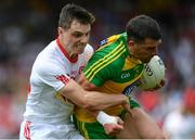 18 June 2017; Paddy McGrath of Donegal is tackled by David Mulgrew of Tyrone during the Ulster GAA Football Senior Championship Semi-Final match between Tyrone and Donegal at St Tiernach's Park in Clones, Co. Monaghan. Photo by Ramsey Cardy/Sportsfile