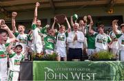 18 June 2017; Ciaran Carroll captain of Kanturk GAA, Club, Co. Cork lifts the trophy after the Division 6 Final at the John West Féile na nGael national competition which took place this weekend across Carlow, Kilkenny and Waterford. This is the second year that the Féile na nGael and Féile Peile na nÓg have been sponsored by John West, one of the world's leading suppliers of fish. The competition gives up-and-coming GAA superstars the chance to participate and play in their respective Féile tournament, at a level which suits their age, skills and strengths. Photo by Matt Browne/Sportsfile