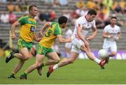 18 June 2017; Sean Cavanagh of Tyrone  in action against Cian Mulligan and Neil McGee of Donegal  during the Ulster GAA Football Senior Championship Semi-Final match between Tyrone and Donegal at St Tiernach's Park in Clones, Co. Monaghan. Photo by Oliver McVeigh/Sportsfile