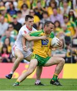 18 June 2017; Neil McGee of Donegal is tackled by David Mulgrew of Tyrone during the Ulster GAA Football Senior Championship Semi-Final match between Tyrone and Donegal at St Tiernach's Park in Clones, Co. Monaghan. Photo by Ramsey Cardy/Sportsfile