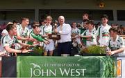18 June 2017; Uachtarán Chumann Lúthchleas Aogán Ó Fearghail presents the trophy to Ciaran Carroll captain  of Kanturk GAA, Club, Co. Cork after the Division 6 Final at the John West Féile na nGael national competition which took place this weekend across Carlow, Kilkenny and Waterford. This is the second year that the Féile na nGael and Féile Peile na nÓg have been sponsored by John West, one of the world's leading suppliers of fish. The competition gives up-and-coming GAA superstars the chance to participate and play in their respective Féile tournament, at a level which suits their age, skills and strengths. Photo by Matt Browne/Sportsfile