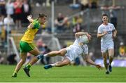18 June 2017; Niall Sludden of Tyrone is tackled by Mícheál Carroll of Donegal during the Ulster GAA Football Senior Championship Semi-Final match between Tyrone and Donegal at St Tiernach's Park in Clones, Co. Monaghan. Photo by Ramsey Cardy/Sportsfile