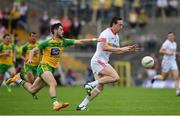 18 June 2017; Colm Cavanagh of Tyrone is tackled by Ryan McHugh of Donegal during the Ulster GAA Football Senior Championship Semi-Final match between Tyrone and Donegal at St Tiernach's Park in Clones, Co. Monaghan. Photo by Ramsey Cardy/Sportsfile