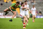 18 June 2017; Ronan McNamee of Tyrone in action against Micheal Carroll of Donegal  during the Ulster GAA Football Senior Championship Semi-Final match between Tyrone and Donegal at St Tiernach's Park in Clones, Co. Monaghan. Photo by Oliver McVeigh/Sportsfile