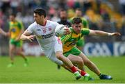 18 June 2017; Mattie Donnelly of Tyrone in action against Patrick McBrearty of Donegal during the Ulster GAA Football Senior Championship Semi-Final match between Tyrone and Donegal at St Tiernach's Park in Clones, Co. Monaghan. Photo by Ramsey Cardy/Sportsfile