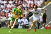 18 June 2017; Martin Reilly of Donegal is tackled by Peter Harte of Tyrone during the Ulster GAA Football Senior Championship Semi-Final match between Tyrone and Donegal at St Tiernach's Park in Clones, Co. Monaghan. Photo by Ramsey Cardy/Sportsfile