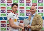 18 June 2017; Tyrone's Mattie Donnelly is presented with the man of the match award by Jim McLaughlin, AIB, following the Ulster GAA Football Senior Championship Semi-Final match between Tyrone and Donegal at St Tiernach's Park in Clones, Co. Monaghan. Photo by Ramsey Cardy/Sportsfile