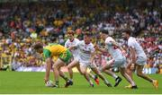 18 June 2017; Hughie McFadden of Donegal under pressure from Tyrone players, from left, Peter Harte, Kieran McGeary, Cathal McCarron and Tiernan McCann during the Ulster GAA Football Senior Championship Semi-Final match between Tyrone and Donegal at St Tiernach's Park in Clones, Co. Monaghan. Photo by Ramsey Cardy/Sportsfile
