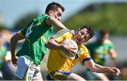18 June 2017; Ciarain Murtagh of Roscommon in action against Paddy Maguire of Leitrim during the Connacht GAA Football Senior Championship Semi-Final match between Roscommon and Leitrim at Dr Hyde Park in Roscommon. Photo by David Maher/Sportsfile