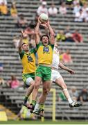 18 June 2017; Michael Murphy and Martin McElhinney of Donegal in action against Colm Cavanagh of Tyrone during the Ulster GAA Football Senior Championship Semi-Final match between Tyrone and Donegal at St Tiernach's Park in Clones, Co. Monaghan. Photo by Oliver McVeigh/Sportsfile