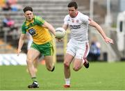 18 June 2017; Sean Cavanagh of Tyrone in action against Kieran Gillespie and Neil McGee of Donegal  during the Ulster GAA Football Senior Championship Semi-Final match between Tyrone and Donegal at St Tiernach's Park in Clones, Co. Monaghan. Photo by Oliver McVeigh/Sportsfile