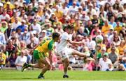18 June 2017; Mark Bradley of Tyrone scores a point before the tackle of Paddy McGrath of Donegal  during the Ulster GAA Football Senior Championship Semi-Final match between Tyrone and Donegal at St Tiernach's Park in Clones, Co. Monaghan. Photo by Oliver McVeigh/Sportsfile