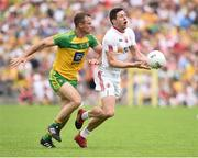 18 June 2017; Sean Cavanagh of Tyrone in action against Neil McGee of Donegal  during the Ulster GAA Football Senior Championship Semi-Final match between Tyrone and Donegal at St Tiernach's Park in Clones, Co. Monaghan. Photo by Oliver McVeigh/Sportsfile