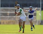 18 June 2017; Colin Walsh of Kanturk GAA, Club, Co. Cork in action against Andrew Fitzhenry of Oylegate-Glenbrien, Co. Wexford during the Division 6 Final at the John West Féile na nGael national competition which took place this weekend across Carlow, Kilkenny and Waterford. This is the second year that the Féile na nGael and Féile Peile na nÓg have been sponsored by John West, one of the world's leading suppliers of fish. The competition gives up-and-coming GAA superstars the chance to participate and play in their respective Féile tournament, at a level which suits their age, skills and strengths. Photo by Matt Browne/Sportsfile