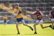 18 June 2017; Seamus O'Connell of Sixmilebridge, Co. Clare in action against Charlie Nolan of Dicksboro, Co. Kilkenny, during the John West Féile na nGael national competition which took place this weekend across Carlow, Kilkenny and Waterford. This is the second year that the Féile na nGael and Féile Peile na nÓg have been sponsored by John West, one of the world's leading suppliers of fish. The competition gives up-and-coming GAA superstars the chance to participate and play in their respective Féile tournament, at a level which suits their age, skills and strengths. Photo by Matt Browne/Sportsfile