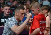 17 June 2017; IBF World Bantamweight Championship Ryan Burnett signs autographs at the Battle of Belfast Fight Night at the Waterfront Hall in Belfast. Photo by Ramsey Cardy/Sportsfile