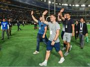 19 June 2017; Ireland players, from left, PaddyJackson, Luke McGrath and Tiernan O'Halloran, wave to the crowd during half-time in the Pearl Bowl, the American Football East Japan Shakaijin Championship Final game between the IBM BigBlue and the OBIC Seagulls, in the Tokyo Dome in Tokyo, Japan. Photo by Brendan Moran/Sportsfile