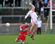 12 February 2012; Owen Mulligan, Tyrone, in action against PJ Quinn, Derry. Allianz Football League, Division 2, Round 2, Tyrone v Derry, Healy Park, Omagh, Co Tyrone. Picture credit: Brian Lawless / SPORTSFILE