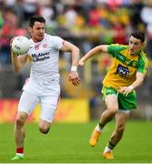 18 June 2017; Mattie Donnelly of Tyrone in action against Eoin McHugh of Donegal during the Ulster GAA Football Senior Championship Semi-Final match between Tyrone and Donegal at St Tiernach's Park in Clones, Co. Monaghan. Photo by Ramsey Cardy/Sportsfile